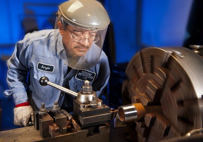 Worker at machine shop